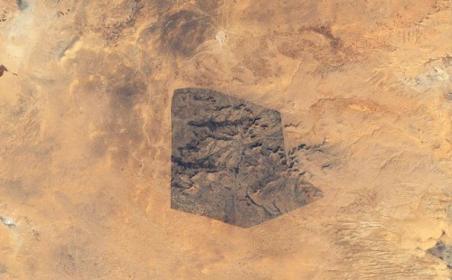 Sidi Toui National Park, in the southern half of Tunisia, close to the Libyan border, viewed by the Enhanced Thematic Mapper Plus (ETM+) instrument on NASA's Landsat 7 satellite on December 13, 1999. Native vegetation can be seen returning inside the borders of this protected park (approx. 7 kilometers wide), established in 1993 to protect the region against desertification. The effects of continued agriculture, overgrazing and drought can be seen on the surrounding arid landscape. (NASA/Jesse Allen/Landsat,USGS) #