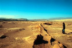 Remains of a Nasca canal cross a desertified landscape in the lower Ica Valley, Peru.